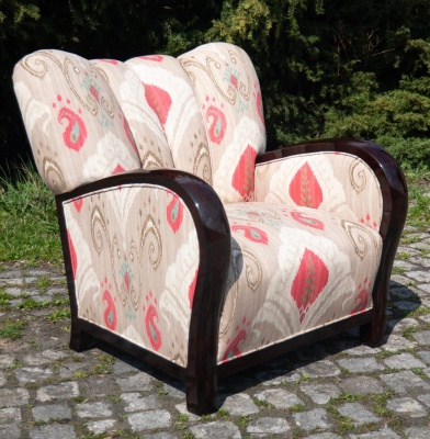 Two armchairs with different and unique fabrics